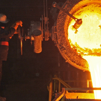 Worker pouring molten metal